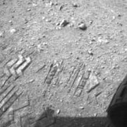 The image shows a close-up of track marks left by NASA's Curiosity rover. Image courtesy of NASA/JPL-Caltech